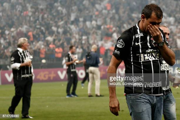 Brazil's Corinthians team coach Fabio Carille becomes emotional after winning their 2017 Brazilian championship football match against Brazil's...