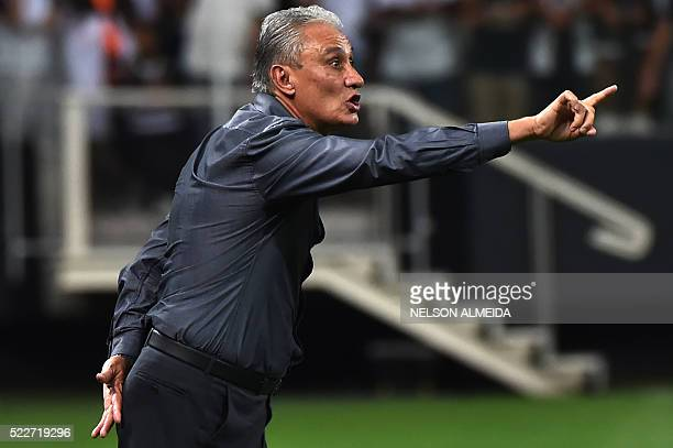 Brazils Corinthians team coach Tite gestures during the 2016 Copa Libertadores football match against Chile's Cobresal held at Arena Corinthians...