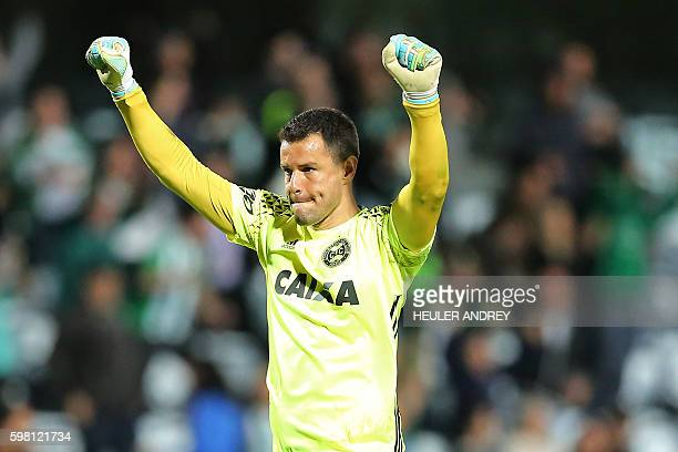 Brazil's Coritiba goalkeeper Wilson Rodrigues celebrates after winning to Brazil's Vitoria during a Sudamericana Cup football match at the Couto...