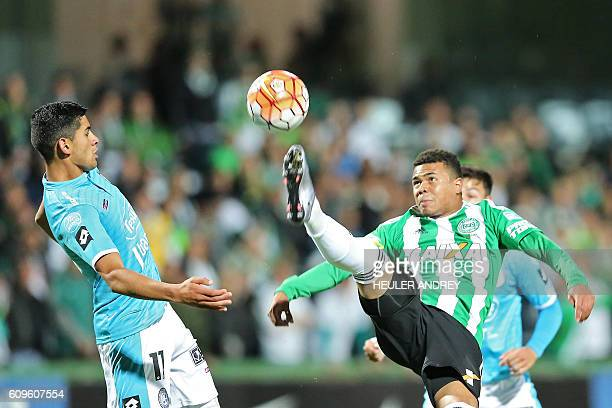 Brazil's Coritiba player Yan Sasse vies for the ball with Lujan Nahuel of Argentina's Belgrano during a Copa Sudamericana football match at the Couto...