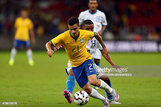 Brazil's Coutinho vies for the ball with Honduras' Luis Garrido during a friendly football match in preparation for the Copa America Chile 2015 at...