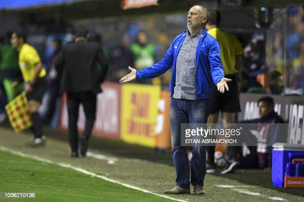 Brazil's Cruzeiro coach Mano Menezes gestures during the Copa Libertadores 2018 quarter final first leg football match against Argentina's Boca...