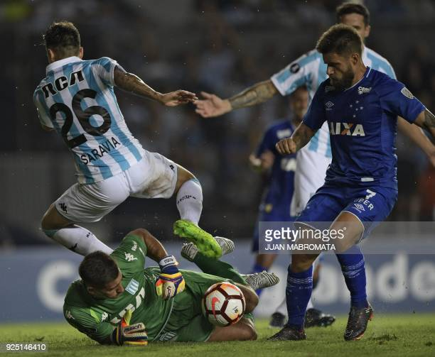 Brazil's Cruzeiro forward Rafael Sobis vies for the ball with Argentina's Racing Club goalkeeper Juan Musso and defender Renzo Saravia during their...