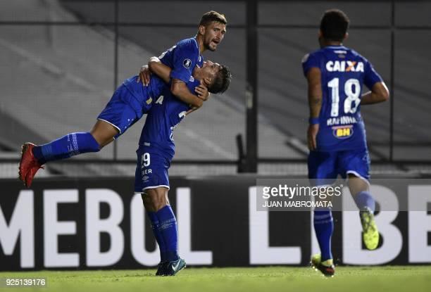 Brazil's Cruzeiro midfielder Giorgian De Arrascaeta celebrates with teammate midfielder Lucas Romero after scoring a goal against Argentina's Racing...
