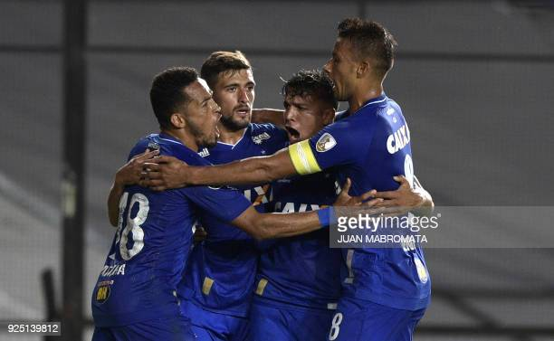 Brazil's Cruzeiro midfielder Giorgian De Arrascaeta celebrates with teammates after scoring a goal against Argentina's Racing Club during the Copa...