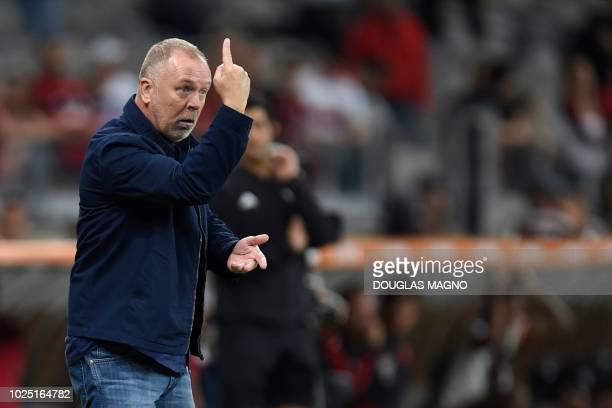 Brazil's Cruzeiro team coach Mano Menezes gestures during a 2018 Copa Libertadores football match against Brazil's Flamengo at Mineirao stadium in...