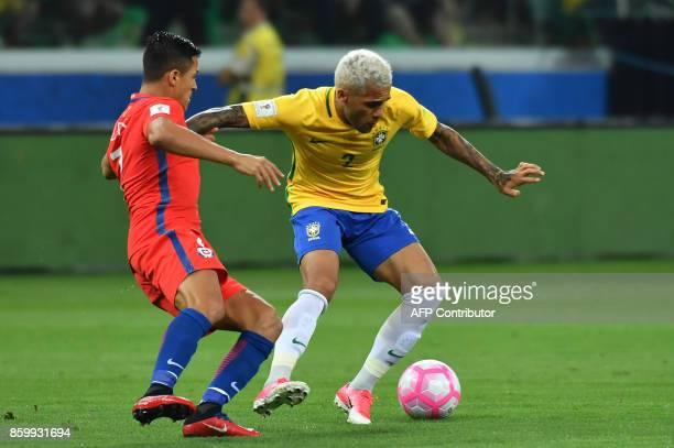 Brazil's Dani Alves and Chile's Alexis Sanchez vie for the ball during their FIFA 2018 World Cup qualifier football match in Sao Paulo Brazil on...