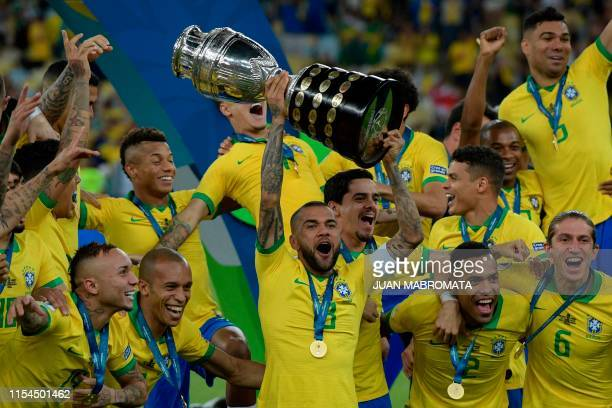Brazil's Dani Alves and teammates celebrates with the trophy after winning the Copa America after defeating Peru in the final match of the football...
