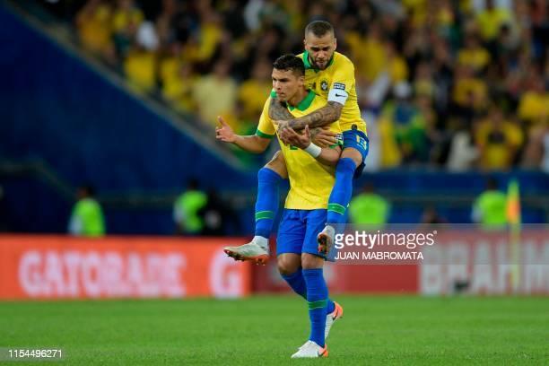 Brazil's Dani Alves and Thiago Silva celebrate after teammate Gabriel Jesus scored the team's second goal against Peru during the Copa America...