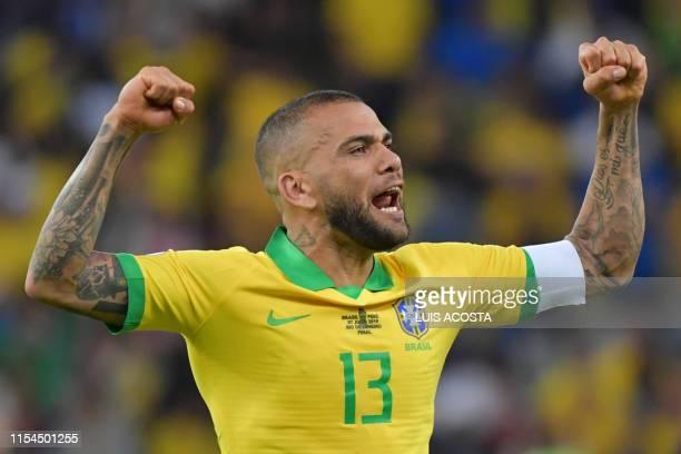 TOPSHOT Brazil's Dani Alves celbrates after defeating Peru to win the Copa America football tournament at Maracana Stadium in Rio de Janeiro Brazil...
