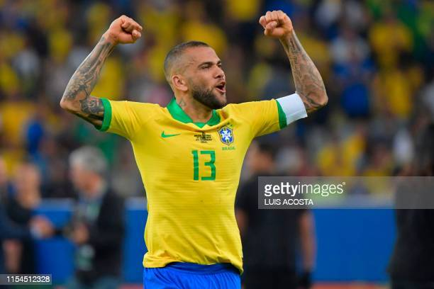 Brazil's Dani Alves celebrates after defeating Peru to win the Copa America football tournament at Maracana Stadium in Rio de Janeiro, Brazil, on...