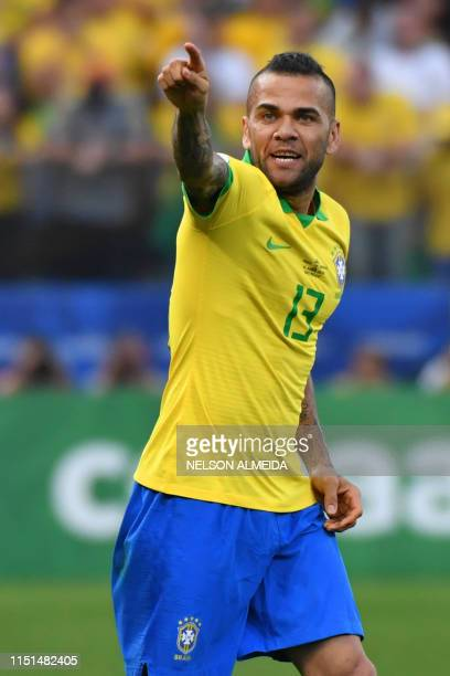 TOPSHOT Brazil's Dani Alves celebrates after scoring against Peru during their Copa America football tournament group match at the Corinthians Arena...