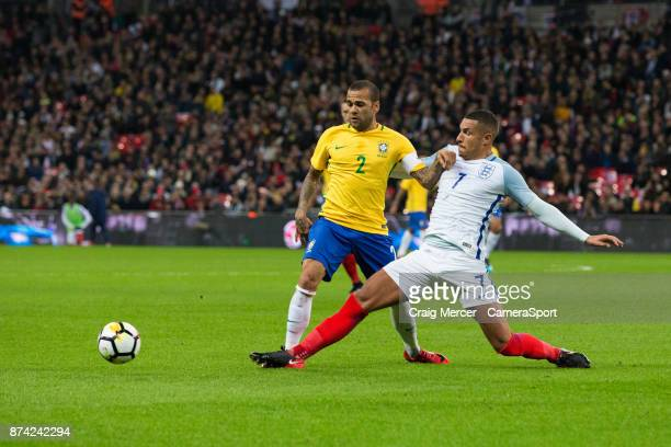 Brazils Dani Alves is tackled by England's Jake Livermore during the Bobby Moore Fund International between England and Brazil at Wembley Stadium on...