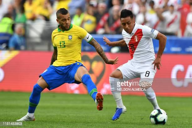 Brazil's Dani Alves marks Peru's Christian Cueva during their Copa America football tournament group match at the Corinthians Arena in Sao Paulo,...
