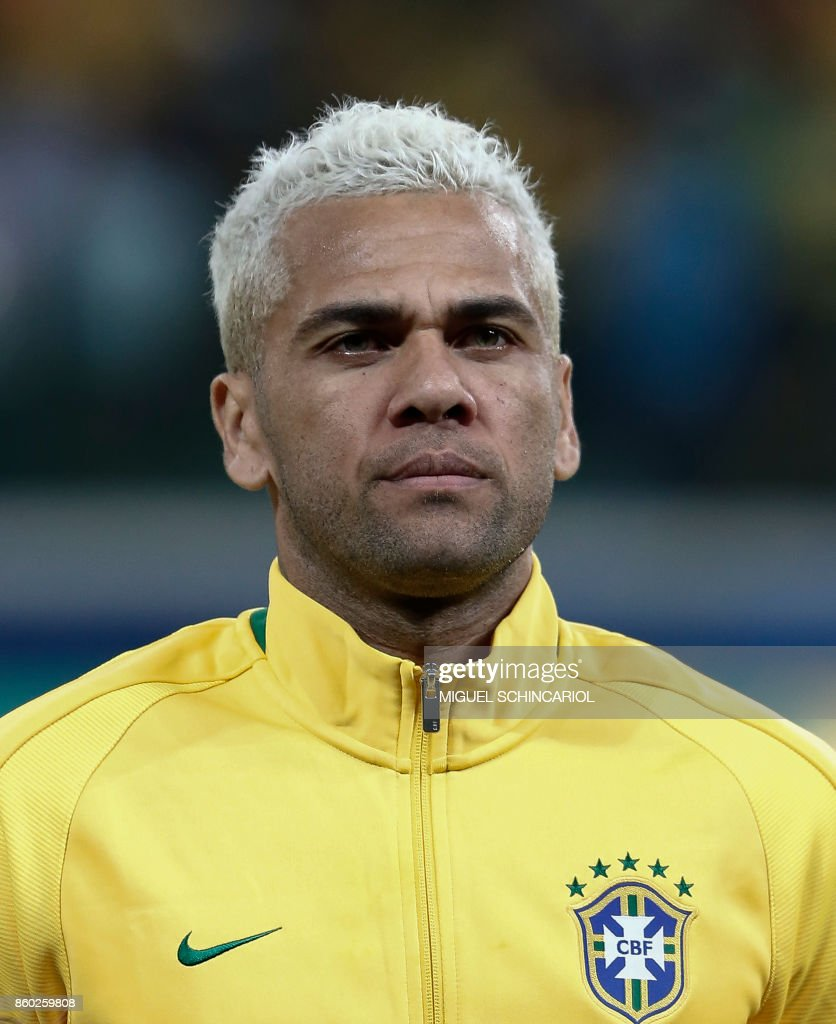 Brazil's Dani Alves poses before the FIFA 2018 World Cup qualifier football match against Chile in Sao Paulo, Brazil, on October 10, 2017.