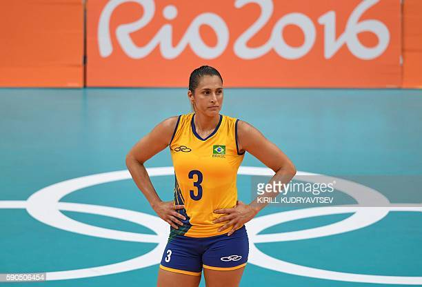 Brazil's Danielle Lins looks on during the women's quarterfinal volleyball match between Brazil and China at the Maracanazinho stadium in Rio de...