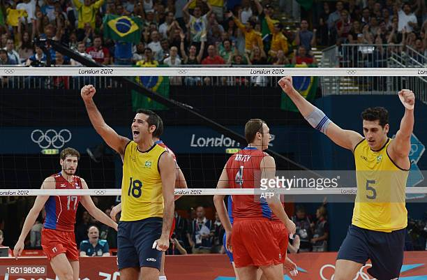 Brazil's Dante Amaral and Sidnei dos Santos Junior celebrate during the men's volleyball gold medal match of the London 2012 Olympics Games against...