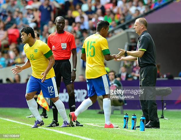 Brazil's defender Alex Sandro leaves the field after being replaced by Brazil's forward Hulk during the men's football final match between Brazil and...