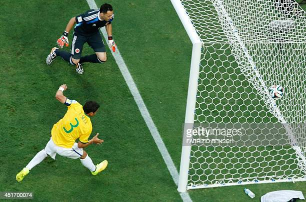 Brazil's defender and captain Thiago Silva scores during the quarterfinal football match between Brazil and Colombia at the Castelao Stadium in...