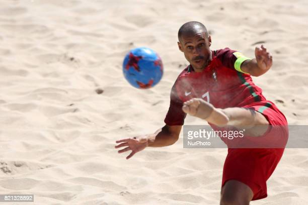 Brazil's defender Bruno Xavier celebrates after scoring a goal during the Beach Soccer Mundialito 2017 match between Portugal and Brazil at the...