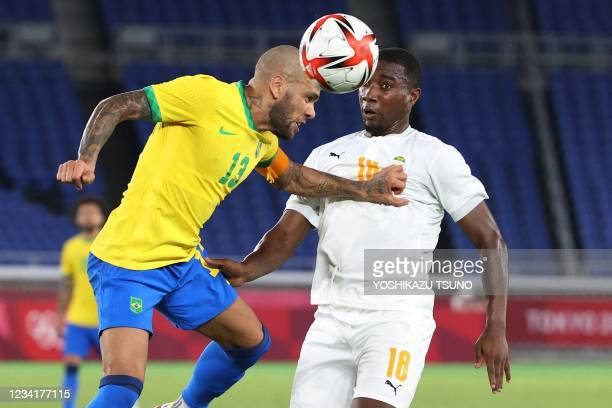 Brazil's defender Dani Alves fights for the ball with Ivory Coast's midfielder Cheick Timite during the Tokyo 2020 Olympic Games men's group D first...
