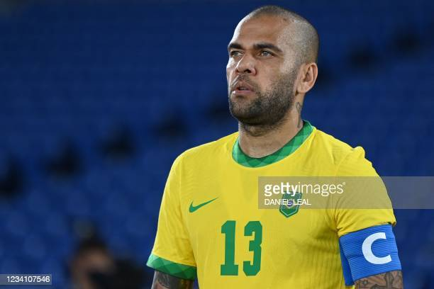 Brazil's defender Dani Alves looks on prior to the Tokyo 2020 Olympic Games men's group D first round football match between Brazil and Germany at...
