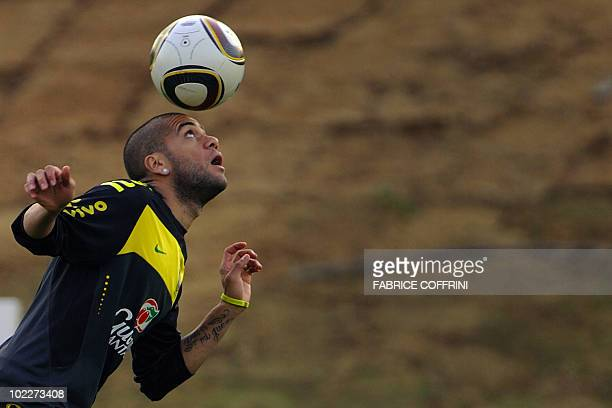 Brazil's defender Daniel Alves plays with the ball during a training session at St Stithians College on June 21 2010 in Johannesburg during the 2010...