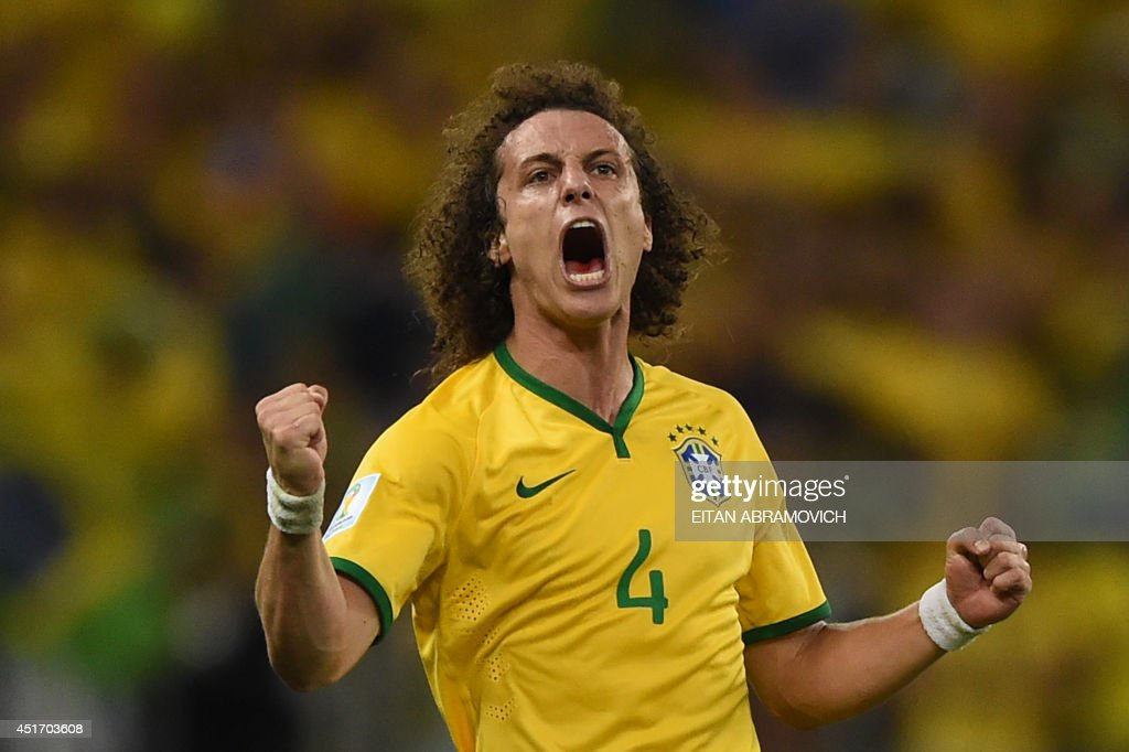 Brazil's defender David Luiz celebrates after scoring during the quarter-final football match between Brazil and Colombia at the Castelao Stadium in Fortaleza during the 2014 FIFA World Cup on July 4, 2014. AFP PHOTO / EITAN ABRAMOVICH / AFP PHOTO / Eitan ABRAMOVICH