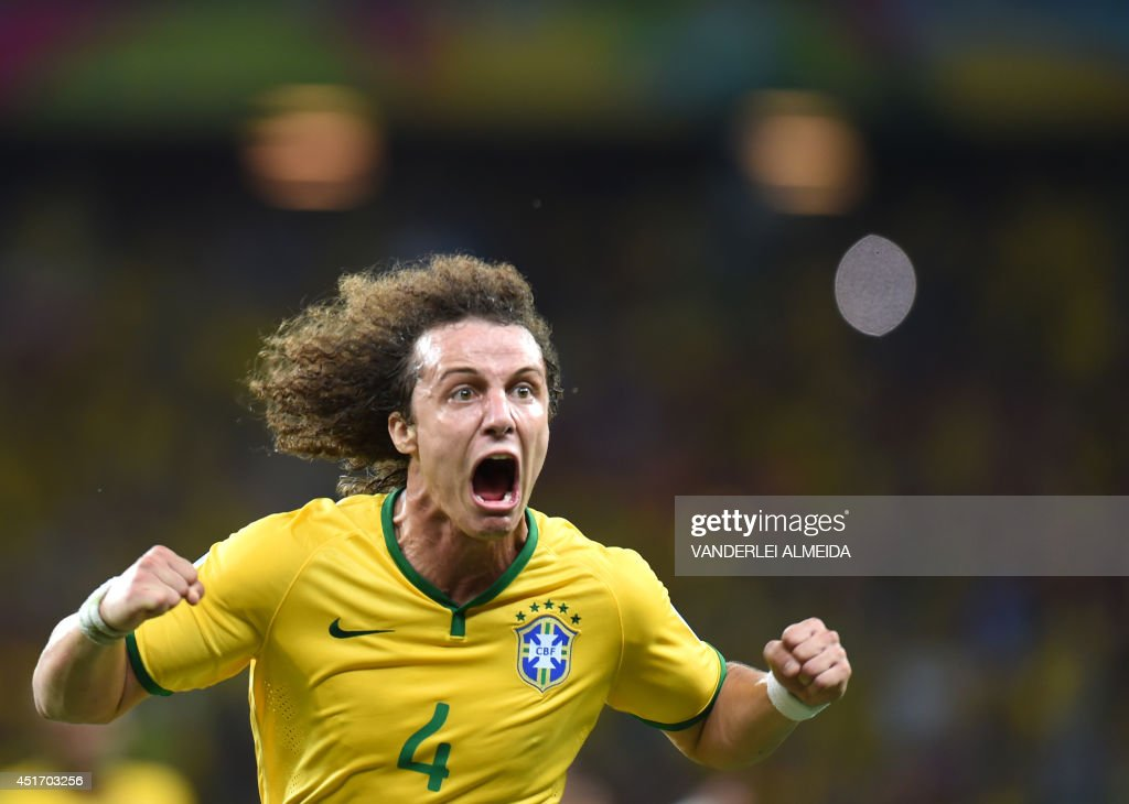 Brazil's defender David Luiz celebrates scoring during the quarter-final football match between Brazil and Colombia at the Castelao Stadium in Fortaleza during the 2014 FIFA World Cup on July 4, 2014.