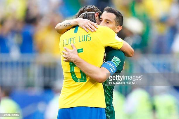 Brazil's defender Filipe Luis hugs Mexico's midfielder Andres Guardado at the end of the Russia 2018 World Cup round of 16 football match between...
