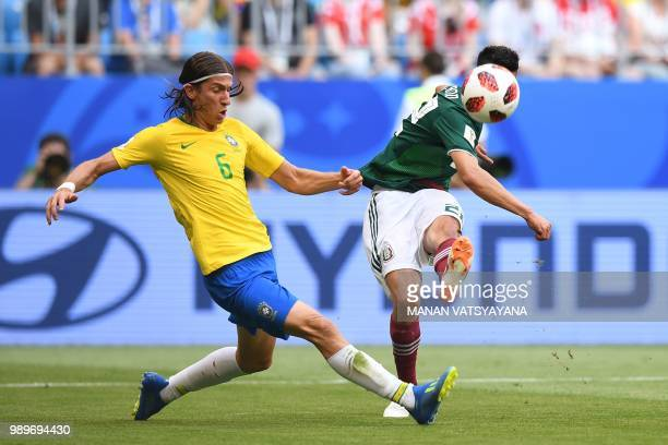 Brazil's defender Filipe Luis vies for the ball with Mexico's forward Hirving Lozano during the Russia 2018 World Cup round of 16 football match...