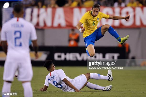 Brazil's defender Filipe Luis vies for the ball with US midfielder Weston McKennie during the international friendly match between Brazil and the US...