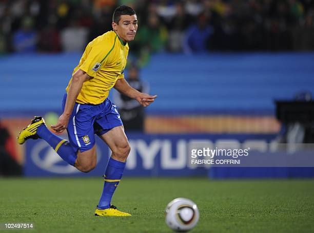 Brazil's defender Lucio runs with the ball during the 2010 World Cup round of 16 football match Brazil vs Chile on June 28 2010 at Ellis Park stadium...