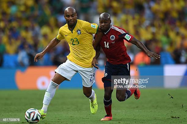 Brazil's defender Maicon vies with Colombia's forward Victor Ibarbo during the quarterfinal football match between Brazil and Colombia at the...