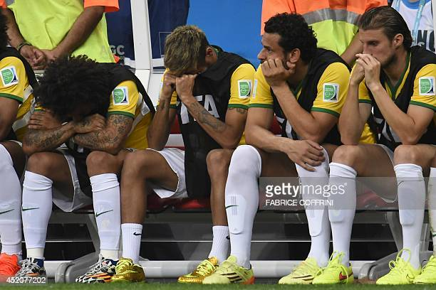 Brazil's defender Marcelo Brazil's injured forward Neymar Brazil's forward Fred and Brazil's defender Henrique react on the bench at the end of the...
