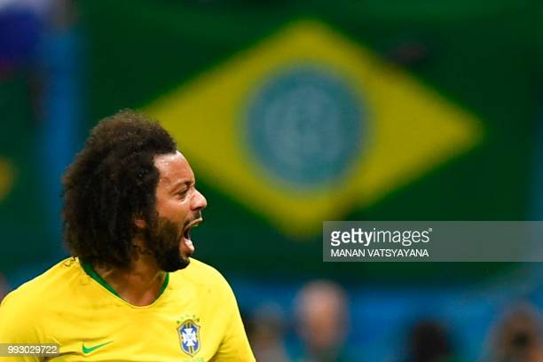 TOPSHOT Brazil's defender Marcelo reacts during the Russia 2018 World Cup quarterfinal football match between Brazil and Belgium at the Kazan Arena...