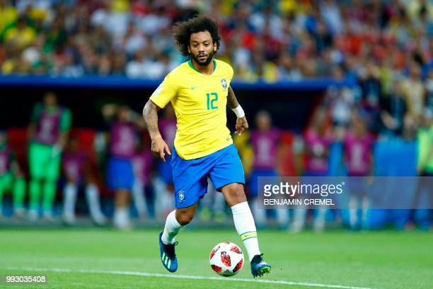Brazil's defender Marcelo runs with the ball during the Russia 2018 World Cup quarterfinal football match between Brazil and Belgium at the Kazan...
