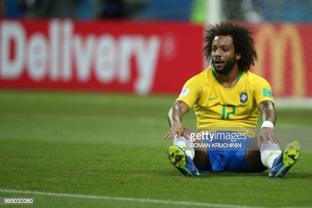 TOPSHOT Brazil's defender Marcelo sits on the pitch during the Russia 2018 World Cup quarterfinal football match between Brazil and Belgium at the...