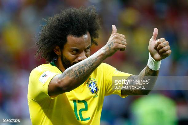 Brazil's defender Marcelo thumbs up during the Russia 2018 World Cup quarterfinal football match between Brazil and Belgium at the Kazan Arena in...