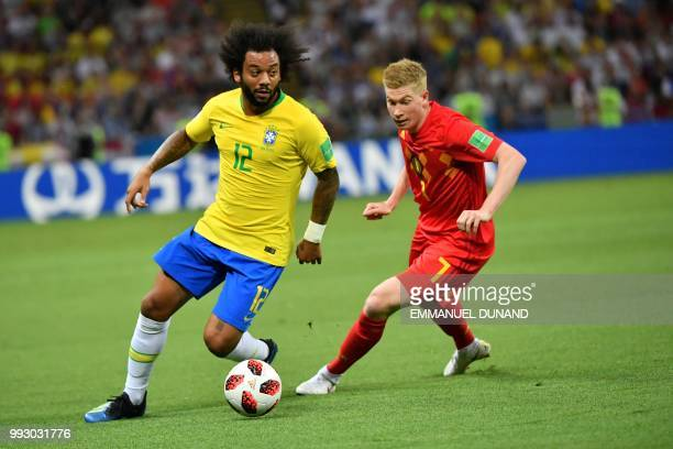 Brazil's defender Marcelo vies with Belgium's midfielder Kevin De Bruyne during the Russia 2018 World Cup quarterfinal football match between Brazil...