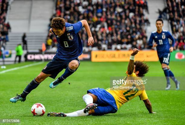 Brazil's defender Marcelo vies with Japan's forward Haraguchi Genki during Japan's friendly football match against Brazil on November 10, 2017 at the...
