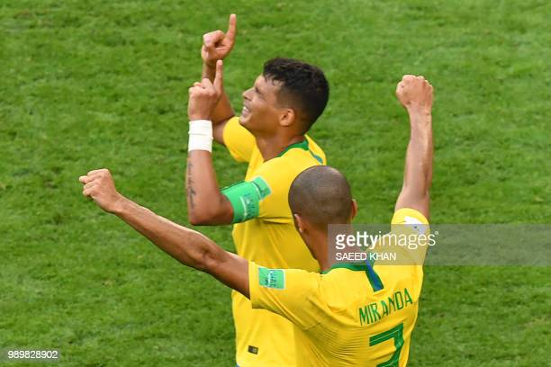 Brazil's defender Miranda and Brazil's defender Thiago Silva react to their win during the Russia 2018 World Cup round of 16 football match between...