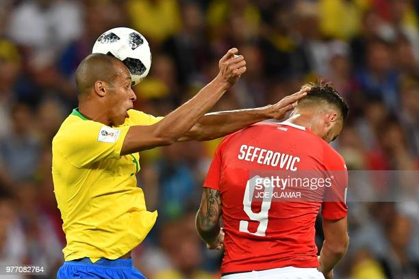 Brazil's defender Miranda and Switzerland's forward Haris Seferovic compete for the ball during the Russia 2018 World Cup Group E football match...