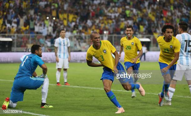 TOPSHOT Brazil's defender Miranda celebrates after scoring a goal during the friendly football match Brazil vs Argentina at the King Abdullah Sport...