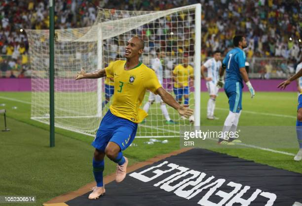 Brazil's defender Miranda celebrates after scoring a goal during the friendly football match Brazil vs Argentina at the King Abdullah Sport City...