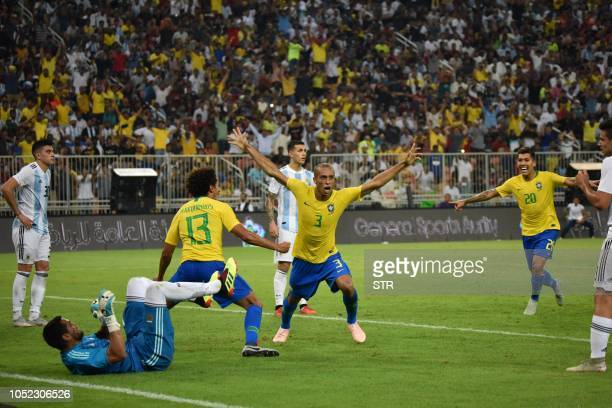 Brazil's defender Miranda celebrates after scoring a goal during the international friendly match Brazil vs Argentina at the King Abdullah Sport City...