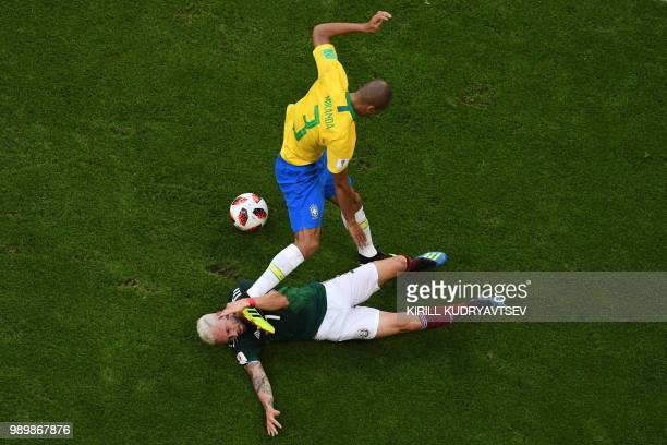Brazil's defender Miranda hits Mexico's defender Miguel Layun during the Russia 2018 World Cup round of 16 football match between Brazil and Mexico...