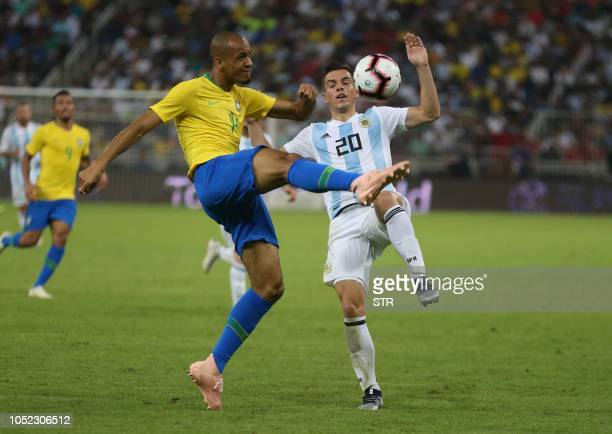 Brazil's defender Miranda kicks the ball before Argentina's midfielder Giovani Lo Celso during the international friendly match Brazil vs Argentinaat...