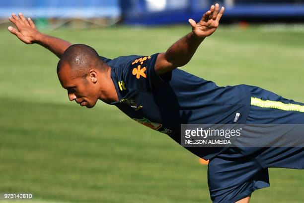 Brazil's defender Miranda stretches as he takes part in a training session of the Brazilian national football team at the Yug Sports stadium in Sochi...
