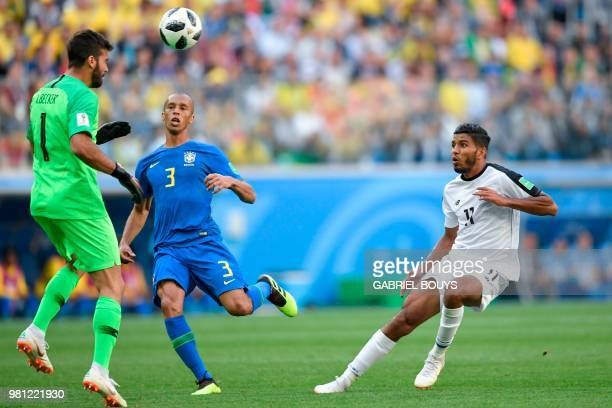 Brazil's defender Miranda vies with Costa Rica's midfielder Celso Borges in front of Brazil's goalkeeper Alisson during the Russia 2018 World Cup...